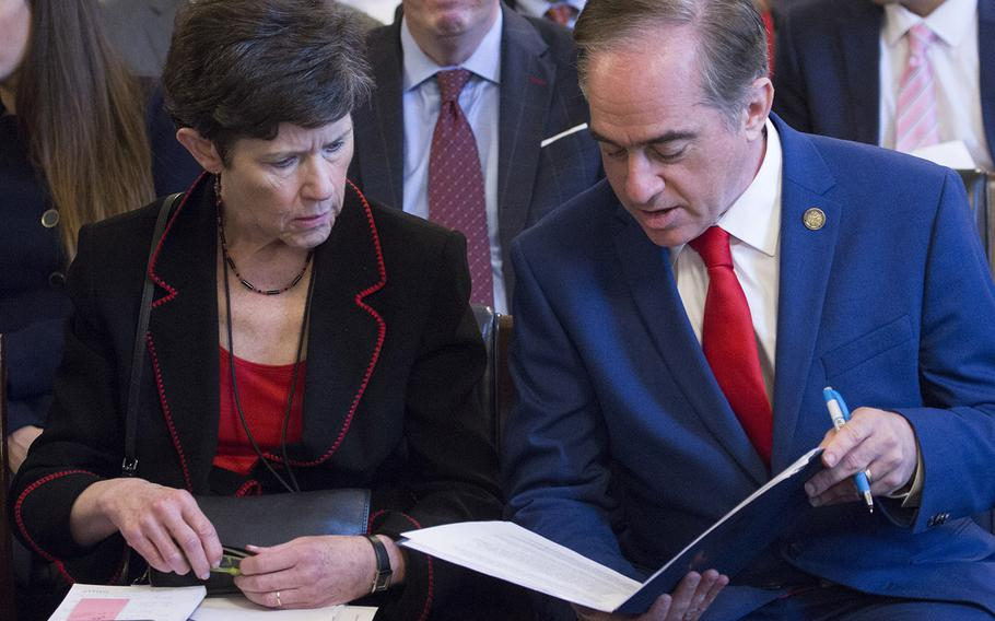 VA Secretary David Shulkin and Veterans Health Administration Executive in Charge Carolyn Clancy go over their notes before a House Veterans' Affairs Committee hearing on Capitol Hill, Oct. 24, 2017.