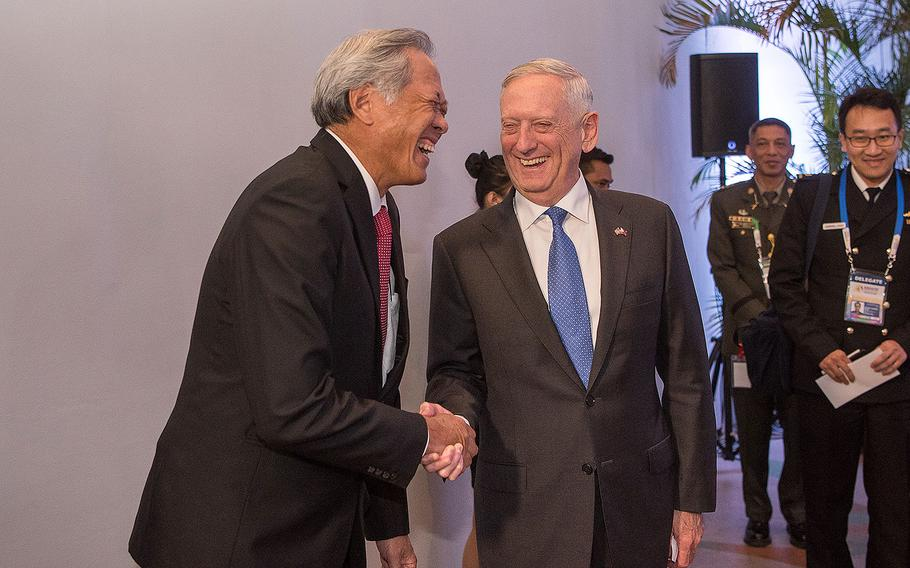 Defense Secretary Jim Mattis shakes hands with Singapore's Minister of Defense Ng Eng Hen following a meeting with the Association of Southeast Asian Nations Defense Ministers (ASEAN) in Clark, Philippines on Oct. 24, 2017.