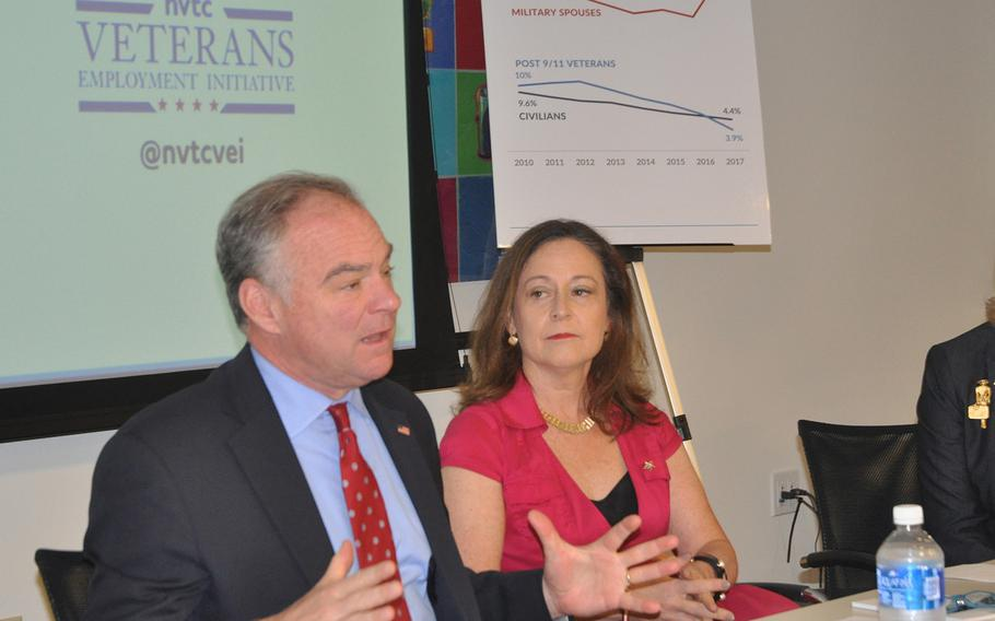Sen. Tim Kaine, D-Va., left, speaks at a summit on military spouse unemployment on Oct. 23 in Arlington, Va. To his right, Blue Star Families CEO Kathy Roth-Douquet, who spearheaded the event, looks on.
