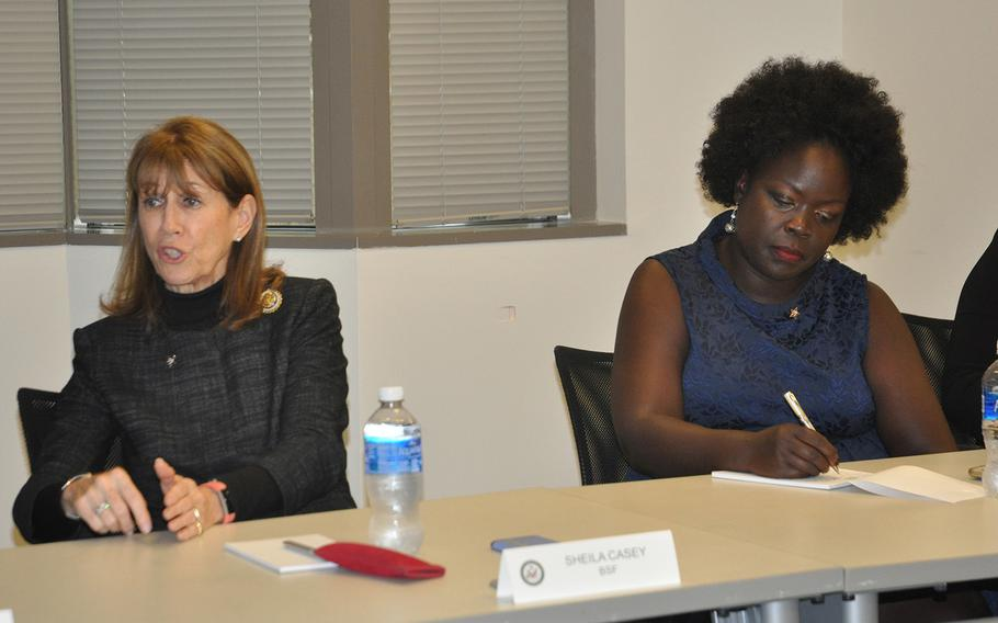 Sheila Casey, COO of the publication The Hill and chair of the board at Blue Star Families, speaks during a summit on military spouse unempoloyment on Oct. 23 in Arlington, VA. To her right, military spouse and caregiver Patricia Ochan, a lawyer with a masters in cyber security, takes notes.