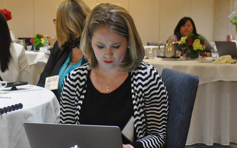 Cyndi Meadows, a graphic artist and virtual assistant who is married to a Navy Explosive Ordnance Disposal technician, takes notes during a business development conference for military spouses on Oct. 13 in Springfield, VA.