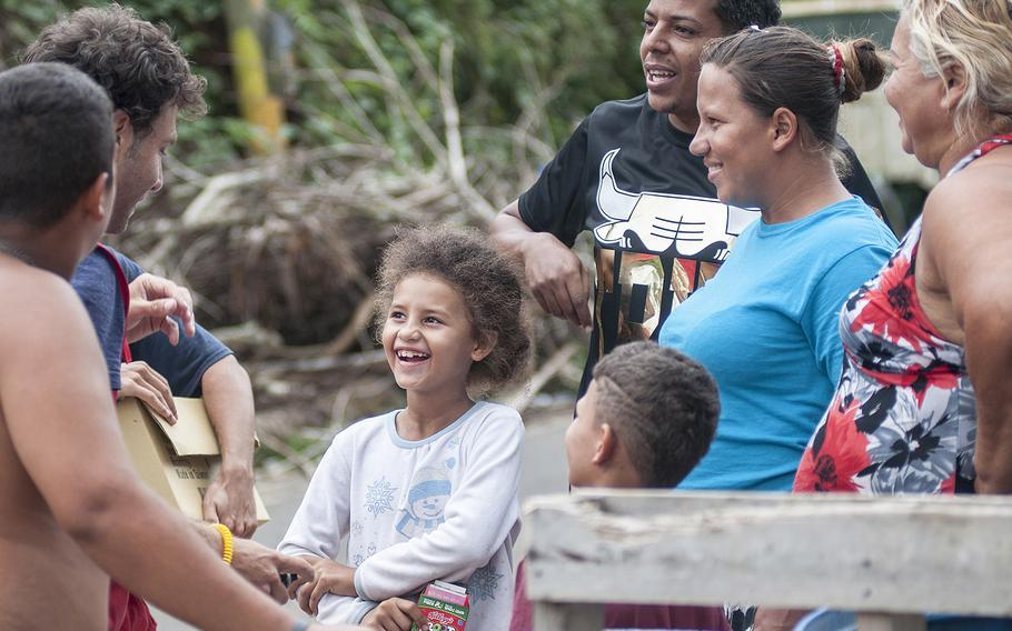 Members of one family in the Comerio region of Puerto Rico were all smiles after receiving a water purifying system, a solar-powered lamp and other gifts on Thursday, Nov. 9, 2017, as a team of Red Cross volunteers visited the area.