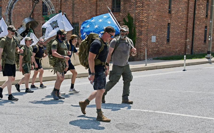 A group of active and retired military and active duty DEA Washington Field Division members walk to Federal Hill Park on Monday, June 7, 2021.