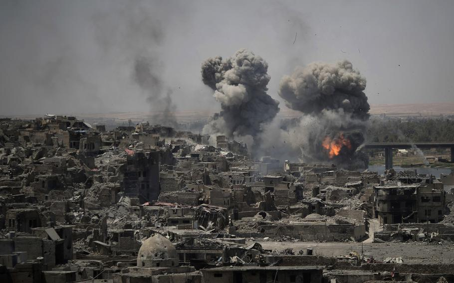 In this July 11, 2017 file photo, airstrikes target Islamic State positions on the edge of the Old City in Mosul, Iraq.