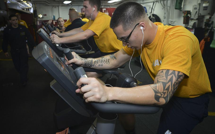 Sailors participate in a physical fitness assessment aboard the aircraft carrier USS Nimitz, June 16, 2017, in the Pacific Ocean.