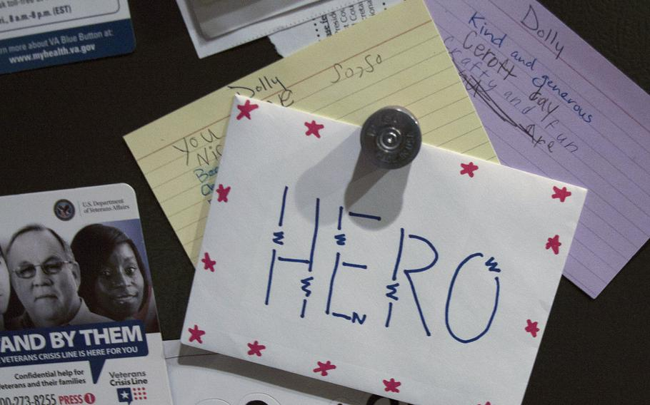 Army veteran Dolly Murphy keeps a note on her refrigerator at her home in West Jordan, Utah, from a high school student thanking her for her service, along with information about the veterans crisis hotline. Murphy struggled with suicidal thoughts, military sexual trauma and post-traumatic stress disorder following her seven years of military service in the 1980s.