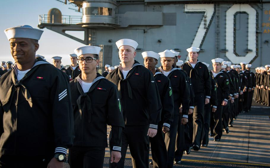 Sailors aboard aircraft carrier USS Carl Vinson prepare to man the rails as the ship departs its homeport of San Diego.