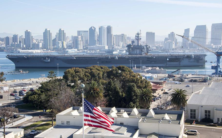 Sailors aboard the aircraft carrier USS Carl Vinson man the rails as the ship departs its homeport of San Diego.