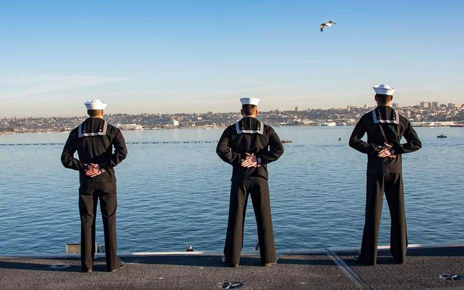 Sailors aboard aircraft carrier USS Carl Vinson man the rails as the ship departs its homeport of San Diego.