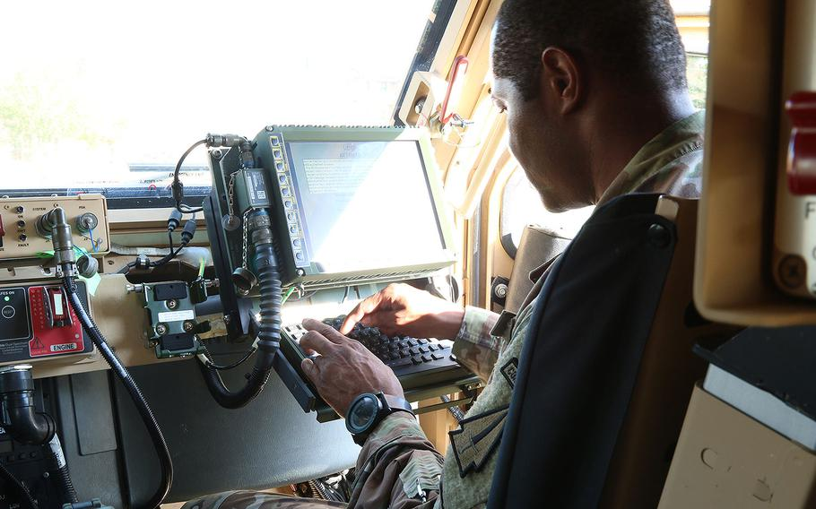 Sgt. 1st Class Douglas King, communication section chief, 4th battalion, 1st Security Force Assistance Brigade, checks his blue force tracker during a brigade system validation exercise at Fort Benning, Ga. on Nov. 7, 2017. The validation exercise was conducted to test out the systems of the new equipment for the newly formed 1st SFAB.