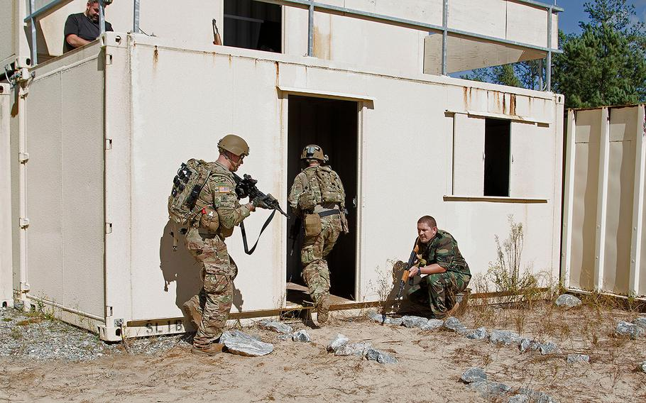 Soldiers of the 1st Squadron, 38th Cavalry Regiment, 1st Security Force Assistance Brigade, work to clear a building during an enacted training event at Lee Field Oct. 23, 2017, on Fort Benning, Ga.