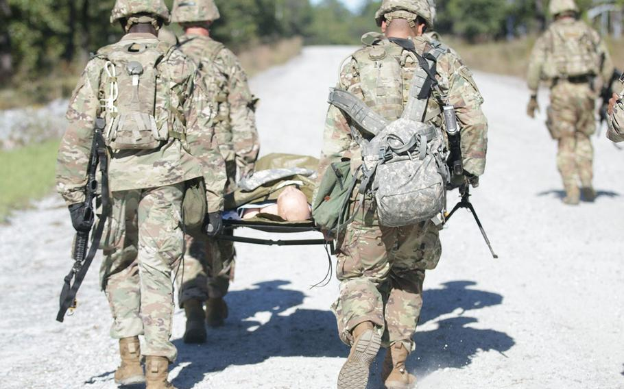 Soldiers with the 815th Brigade Engineer Battalion, 1st Security Force Assistance Brigade transport the injured during medical evacuation training at Fort Benning, Georgia, Oct. 24, 2017. They are the Army's first brigade purposefully built to help combatant commanders accomplish theater security objectives by training, advising, assisting, accompanying and enabling allied and partnered indigenous security forces.