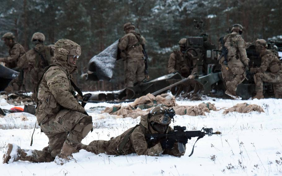 Soldiers with the 173rd Brigade Combat Team (Airborne) provide cover in the snow during an exercise at Grafenwoehr, Germany, on Wednesday, Jan. 17, 2018.