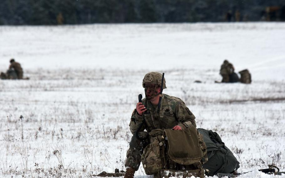 A soldier with the 173rd Brigade Combat Team (Airborne)radios in during an exercise at Grafenwoehr, Germany, Wednesday, Jan. 17, 2018.