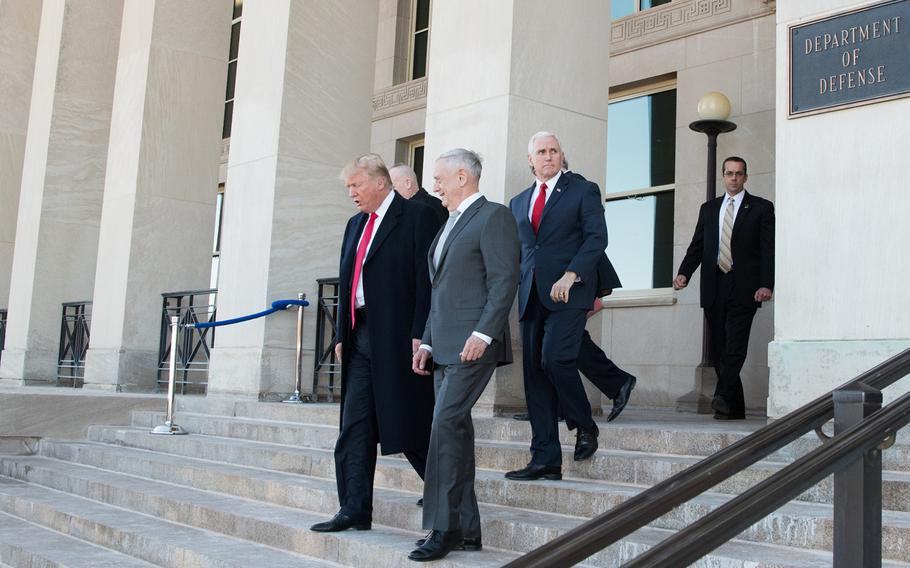President Donald Trump walks with Defense Secretary James N. Mattis following a meeting at the Pentagon in Washington, D.C., Thursday, Jan. 18, 2018. Vice President Mike Pence looks on from behind.