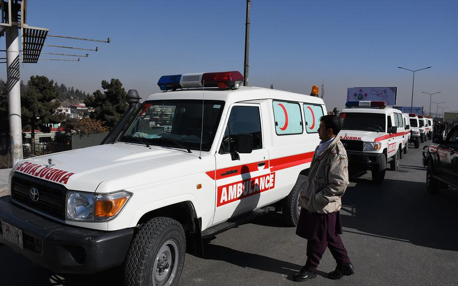 Pictured here on a road outside the Intercontinental Hotel in Kabul, Afghanistan, on Sunday, Jan. 21, 2018, a row of ambulances waits to take casualties to local medical facilities as security forces continue working to clear the hotel of the Taliban gunmen who besieged it in an attack that began late the night before.