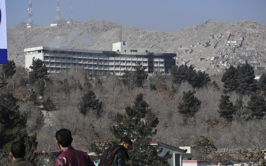 Smoke billows out of the top floor of the Intercontinental Hotel in Kabul, Afghanistan, on Sunday, Jan. 21, 2018. Taliban gunmen stormed the hotel Saturday night, leading to a standoff with Afghan security forces that lasted into the afternoon Sunday, with gunfire and blasts echoing down from the hilltop luxury hotel to where crowds had gathered to watch the siege play out.  Chad Garland/Stars and Stripes