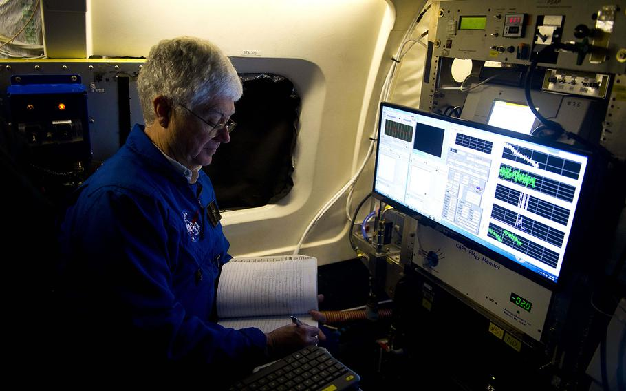 Research scientist Eddie Winstead annotates data during pre-flight checks on NASA's DC-8 Airborne Science Laboratory at Ramstein Air Base, Germany, on Wednesday, Jan. 24, 2018.