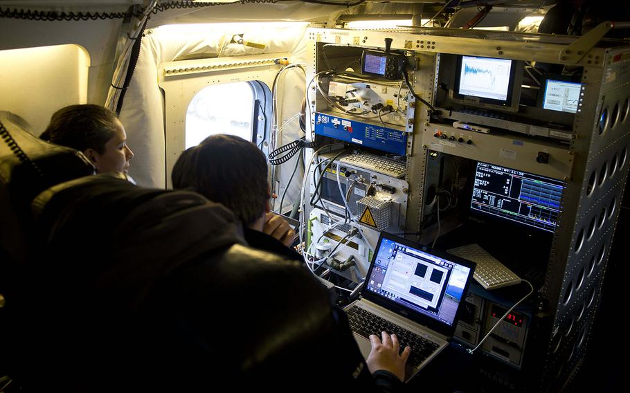 Research scientists check instrument displays during pre-flight checks on NASA's DC-8 Airborne Science Laboratory at Ramstein Air Base, Germany, on Wednesday, Jan. 24, 2018.