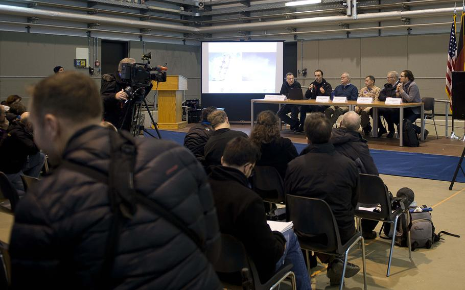 Representatives from the German Aerospace Center and the U.S. National Aeronautics and Space Administration answer questions during a presentation for media members at Ramstein Air Base, Germany, on Wednesday, Jan. 24, 2018. The space agencies are conducting joint research flights in Germany for the first time to study the affect particle emissions have on cloud formation through contrails and their impact on the climate.