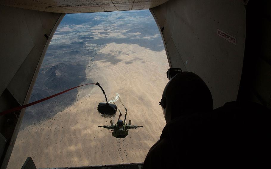 A Marine executes a double-bag static line jump during a parachute training course on Aug 26, 2014 in rural Arizona.