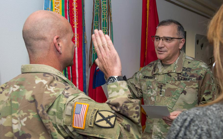 Gen. Curtis M. Scaparrotti, right, reads the oath to defend the U.S. Constitution to Lt. Gen. Christopher G. Cavoli during a promotion ceremony in Wiesbaden, Germany on Jan. 18, 2018.
