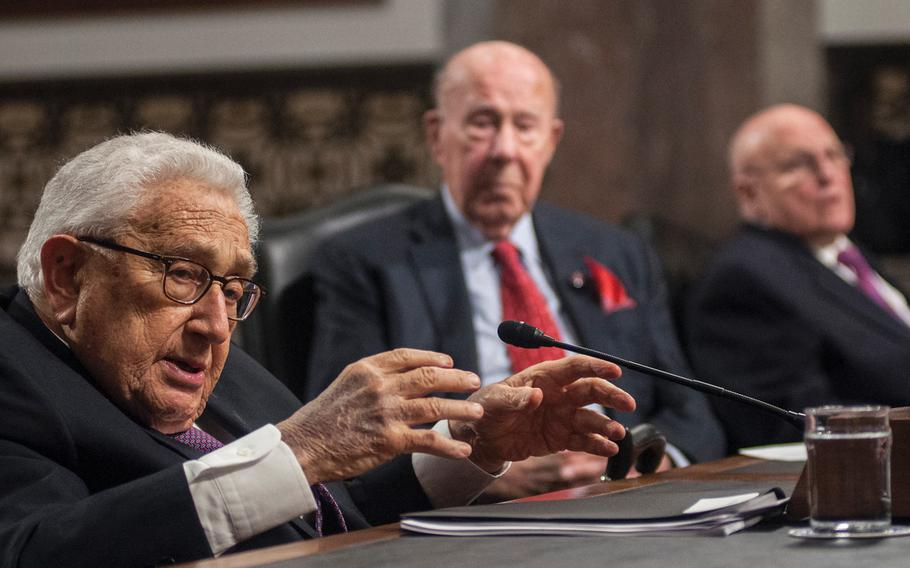 Former Secretary of State Henry Kissinger addresses members of the Senate Armed Services Committee on Capitol Hill in Washington, D.C., on Thursday, Jan. 25, 2018, as former Secretary of State George Shultz, cente,r and former Deputy Secretary of State Richard Armitage listen. Kissinger warned that a collapse of world order has been gaining momentum for two decades.