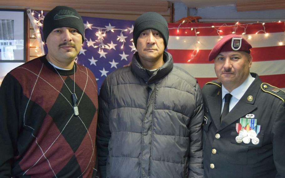 Honorably discharged Marine Marco Chavez, center, stands with Hector Barajas, right, and another veteran on Dec. 21, 2017.