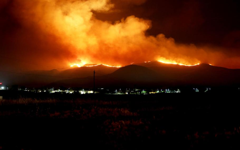 The Tomahawk wildfire burns through the night near Marine Corps Base Camp Pendleton, Calif., May 15, 2014. More than half of 3,500 Defense Department properties experienced climate-related damage in 2014-15, according to a DOD survey sent to Congress Friday.
