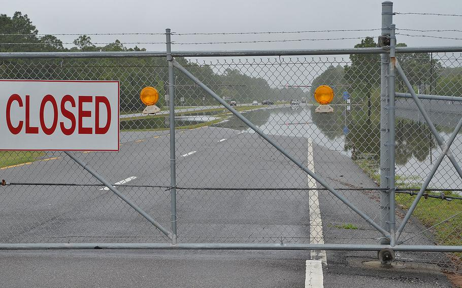 The west gate to Naval Air Station Pensacola is closed due to flooding from a storm starting April 29, 2014. Many areas of the base were inaccessible with water measured in excess of 3.5 feet in low lying areas.