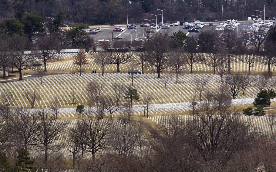 Graves at Arlington National Cemetery, with a Pentagon parking lot in the background, on Jan. 30, 2018.