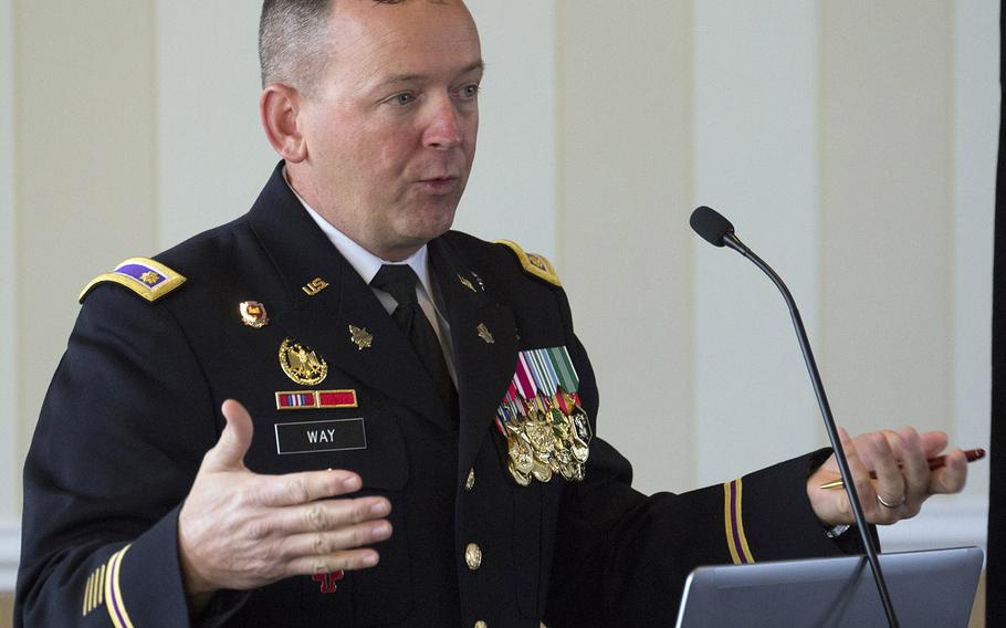 Army Maj. Shannon Way, strategic planner for Arlington National Cemetery, discusses survey results during a roundtable discussion on the cemetery's future, Jan. 30, 2018.