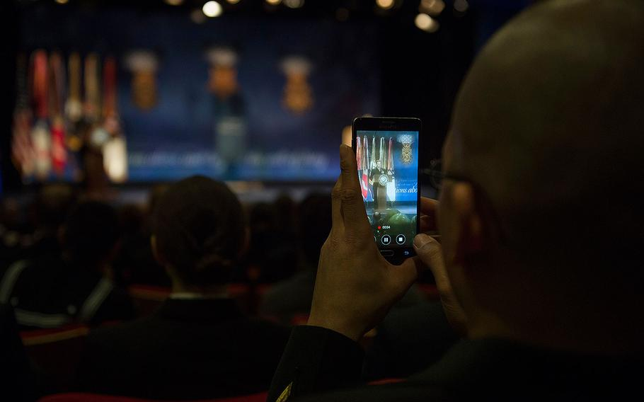An audience member uses his smartphone to record Medal of Honor recipient Navy Senior Chief Edward Byers speak at the Pentagon on March 1, 2016.