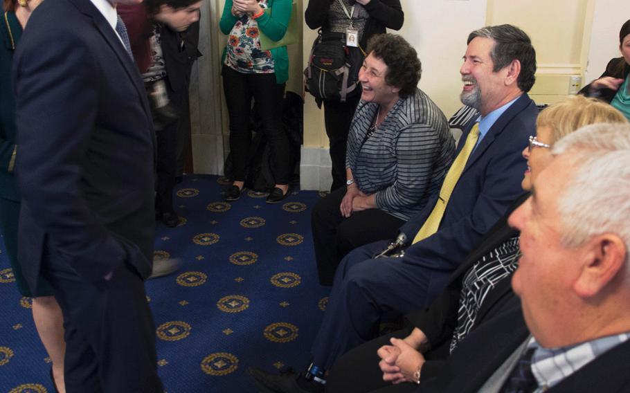 VA Secretary David Shulkin talks with veterans and caregivers before a House Veterans' Affairs Committee hearing on Capitol Hill, Feb. 6, 2018.