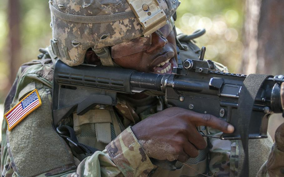 In a November, 2016 file photo, Pvt. Rolando Swaby, an Army Reserve Soldier in basic combat training with Company A, 1st Battalion, 61st Infantry Regiment at Fort Jackson, S.C., takes aim at his target at the hand grenade assault course.