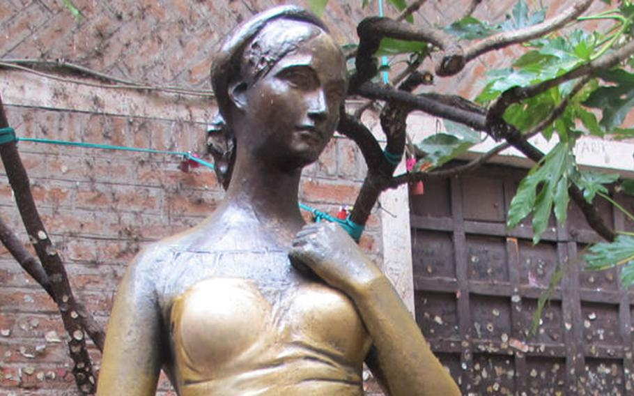 A bronze statue of Shakespeare's Juliet in the courtyard of the Cappelletti house in Verona, Italy, stands alone in a rare unmolested moment.