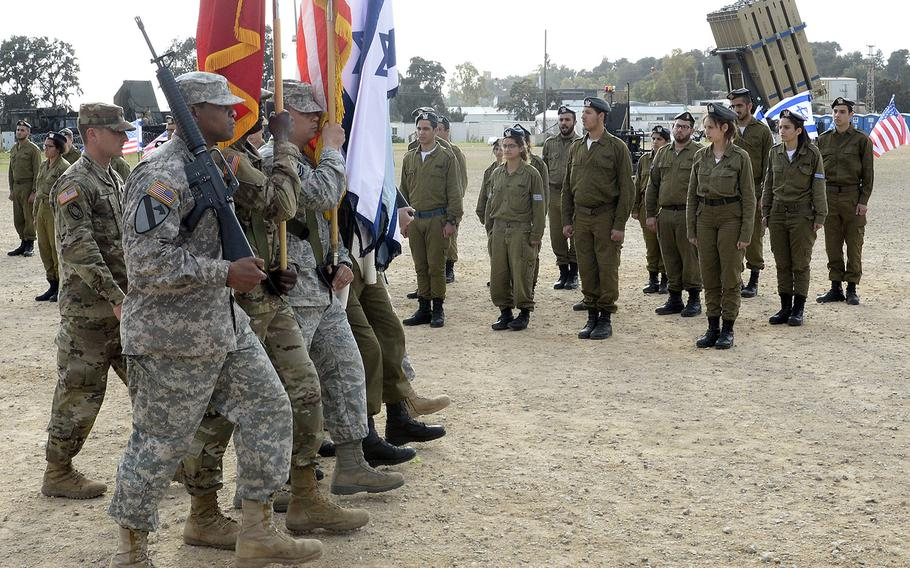 In a March, 2016 file photo, U.S. military and Israeli Defense Forces personnel mark the conclusion of the most recent Juniper Cobra exercise at Hazor Air Force Base, Israel.