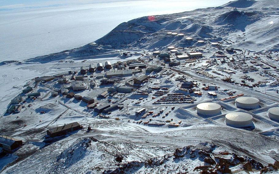 The National Science Foundation's McMurdo Station, as seen from the summit of Observation Hill, Antarctica. The station was established in December 1955 and is the logistics hub of the U.S. Antarctic Program, with a harbor, landing strips on sea ice and shelf ice, and a helicopter pad.