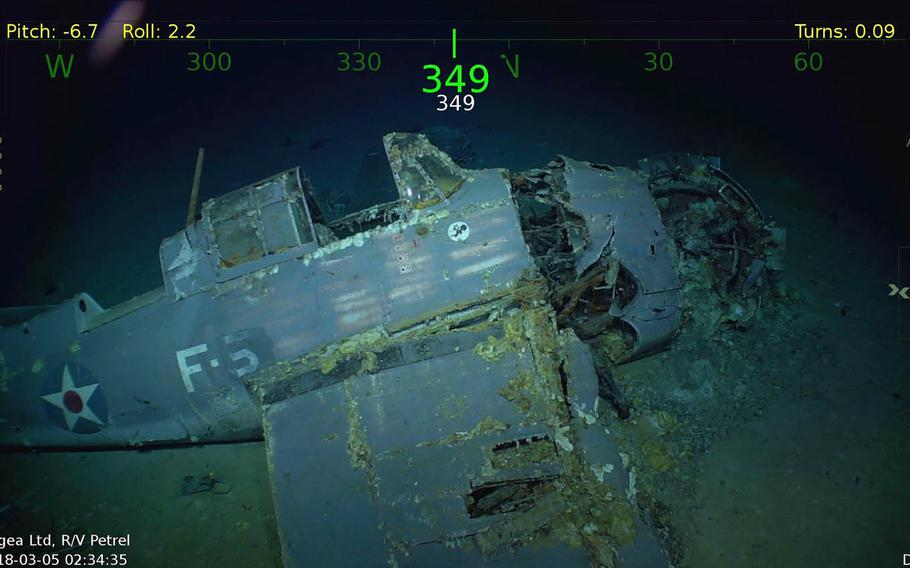An intact fighter plane is still emblazoned with U.S. star emblems at the wreckage of the USS Lexington in the Coral Sea.