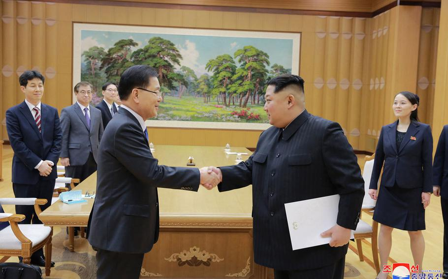 North Korean leader Kim Jong Un, front right, shakes hands with South Korean National Security Director Chung Eui-yong on Monday, March 5, 2018.