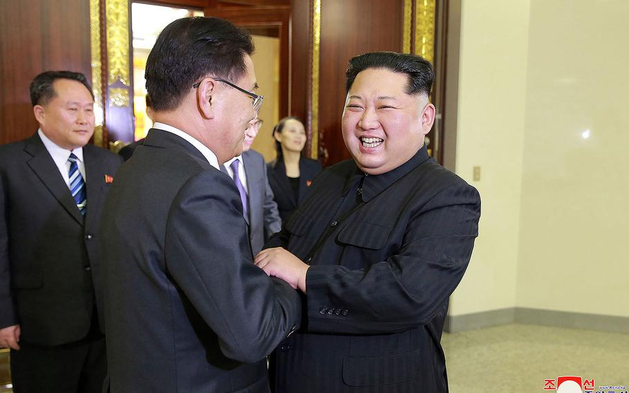 North Korean leader Kim Jong Un, front right, meets South Korean National Security Director Chung Eui-yong, front left, in Pyongyang, North Korea on Monday, March 5, 2018 in this photo provided by the North Korean government.