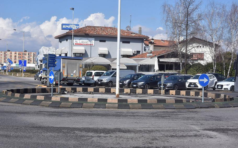 Little evidence is left at the traffic circle on the SS-13 (Via Aquileia) where a U.S. servicemember reportedly lost control of his vehicle in the early morning hours of Feb. 28, 2018, and struck four cars parked in the lot that serves the Al Laghetto bar and restaurant in Pordenone, Italy.