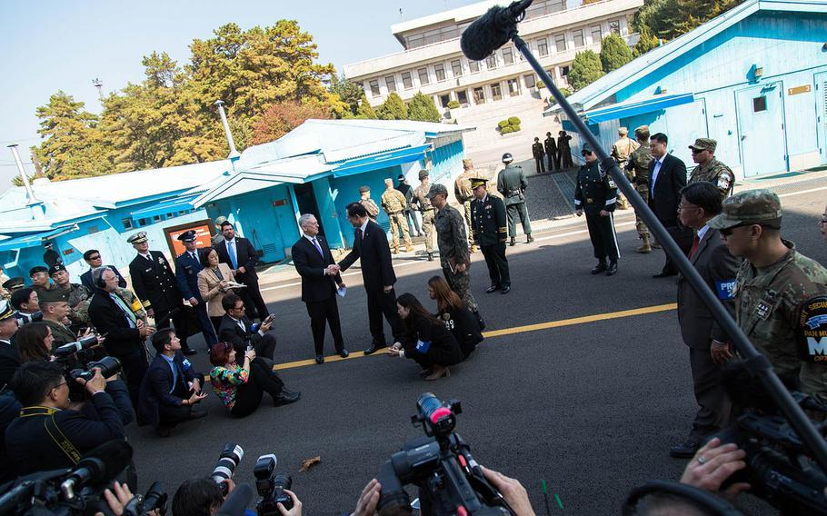 Secretary of Defense Jim Mattis greets South Korean Defense Minister Song Young-moo near the Military Demarcation Line at Panmunjom, South Korea, Friday, Oct. 27, 2017.