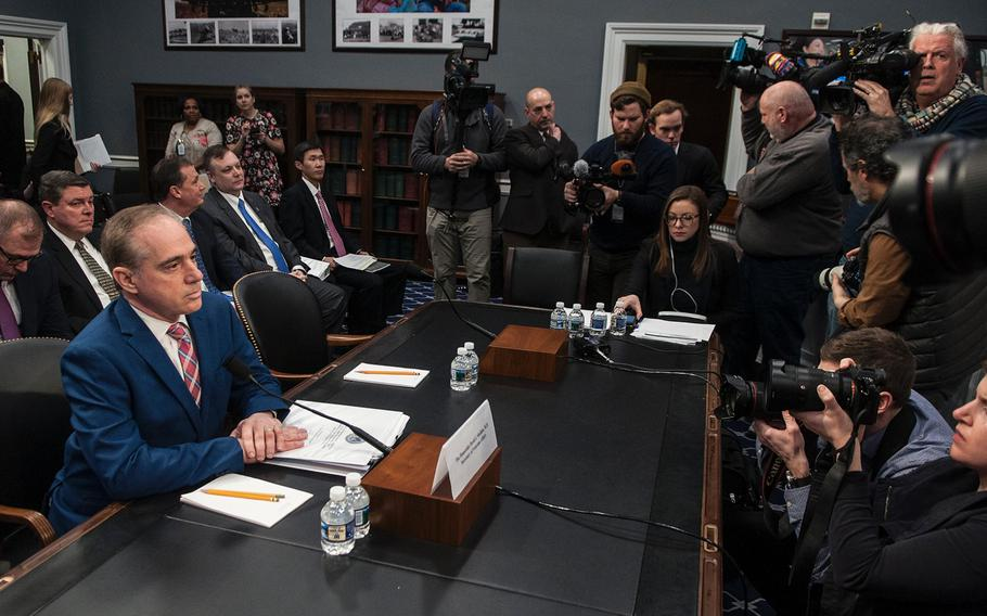 """VA Secretary David Shulkin arrives prior to the start of a House Appropriations Subcommittee on Military Construction, Veterans Affairs and Related Agencies hearing on Capitol Hill in Washington, D.C., on Thursday, March 15, 2018. Shulkin acknowledged reports of an ongoing government audit of his alleged use of his security detail to run personal errand. """"The distraction that has happened is something I deeply regret,"""" he said."""