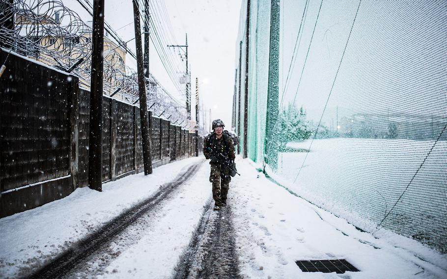 A 19th Expeditionary Sustainment Command best warrior competitor marches 12-miles through a freak snow storm at Camp Walker, South Korea on Thursday, March 8, 2018.