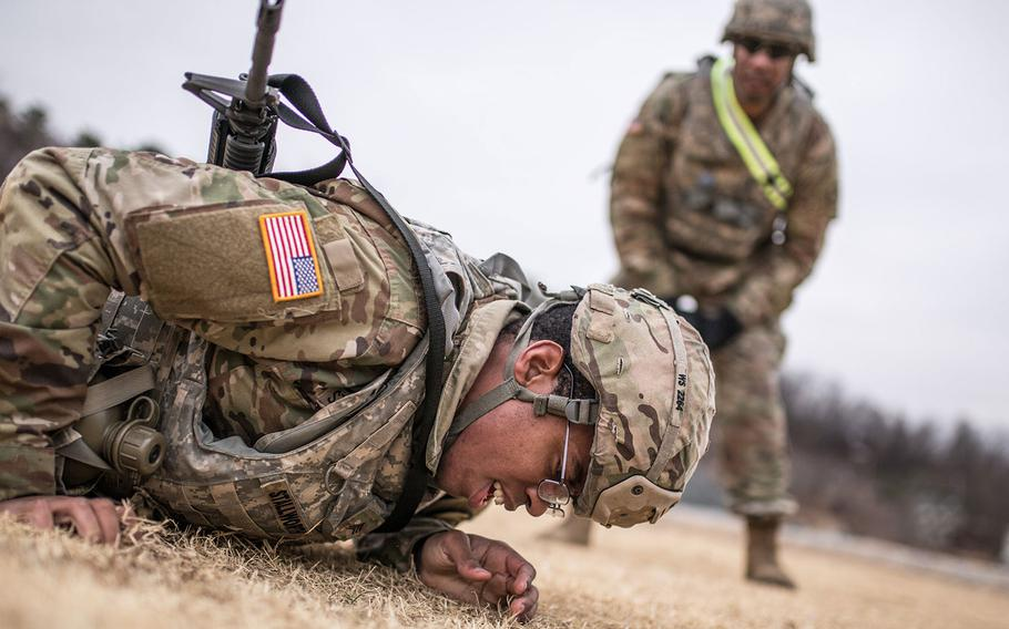 Sgt. William Stallworth, 176th Financial Management Support Unit, 19th Expeditionary Sustainment Command best warrior competitor low crawls during a stress shoot at Masan, South Korea on Wednesday, March ,7, 2018.