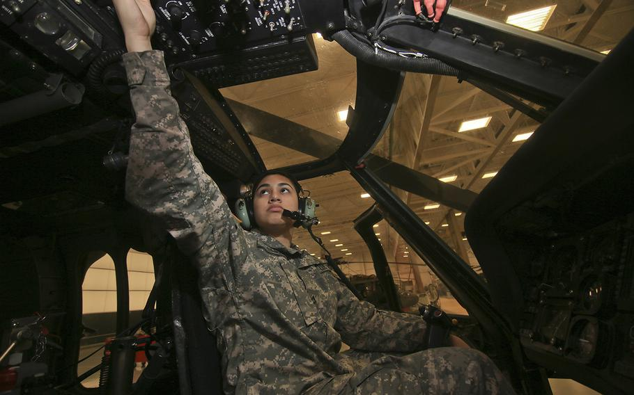 U.S. Army National Guard Private 1st Class Katherine Silva works on a UH-60L Black Hawk helicopter in the New Jersey National Guard's Army Aviation Support Facility, Joint Base McGuire-Dix-Lakehurst, N.J., March 5, 2018.