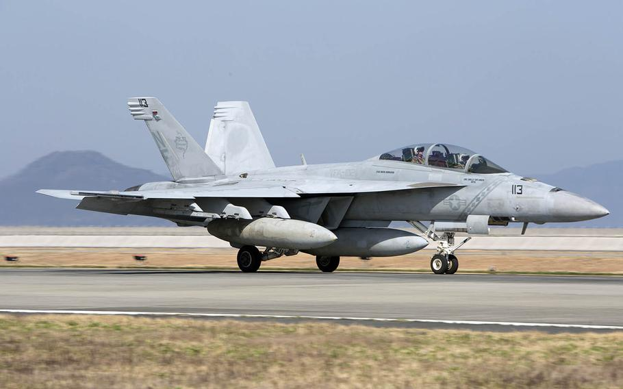 A Navy F/A-18F Super Hornet with Strike Fighter Squadron 102 arrives at Marine Corps Air Station Iwakuni, Japan, Wednesday, March 28, 2018.