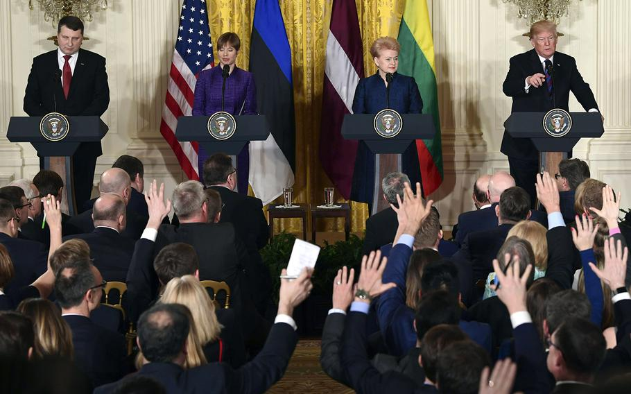 President Donald Trump, left, calls on a reporter as he is joined by, from left, Latvian President Raimonds Vejonis, Estonian President Kersti Kaljulaid, and Lithuanian President Dalia Grybauskaite, for a news conference in the East Room of the White House in Washington, Tuesday, April 3, 2018.