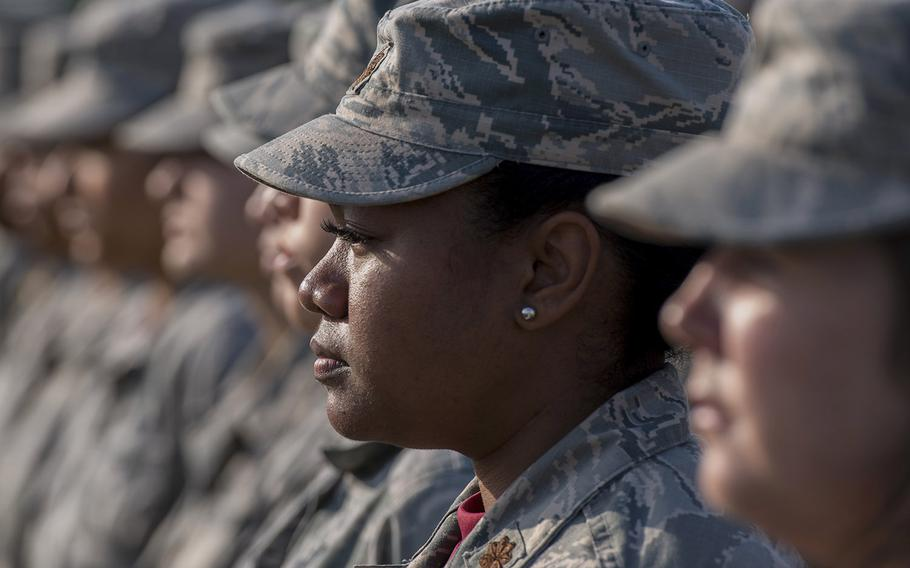 Airmen stand at attention during a retreat ceremony Mar. 30, 2018, on Kadena Air Base, Japan, where an all-female formation was coordinated in honor of Women's History Month.
